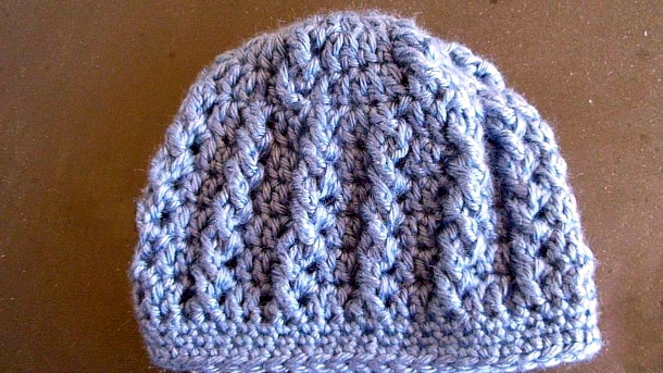 Infant Hat in Simple Cables by Julia Schwartz